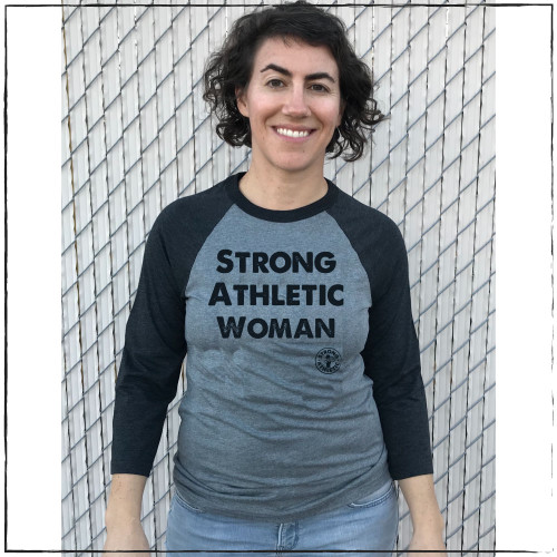 Are you looking for the perfect gift for that strong woman in your life? These tees are perfect for athletic women who want to make a statement. This is the front of the Strong Athletic Woman Baseball T-shirt made by Strong Athletic. This baseball t-shirt is a favorite with strong women. We print this design on the dark gray with gray sleeves Bella Canvas Baseball Tee, style number 3200.