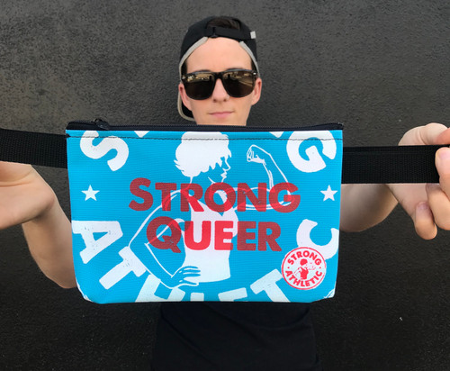 This is the Strong Queer Fanny Pack Light Blue with White and Red Ink created by Strong Athletic and Produced by Hand by Oregon Company Flat Track Revolution. Once you get this bag you'll never leave it at home. #strongathletic #strongathleticqueer #queerathlete #strongqueer #queer
