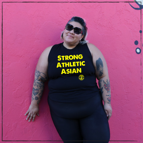 This is the Strong Athletic Asian tank worn on Team Philippines Roller Derby athlete Felice T. This shirt was made by special request from Asian Derby Skaters. 100% of profits are donated with a portion of funds going to Toronto Based Group Raging Asian Womxn Taiko Drummers.