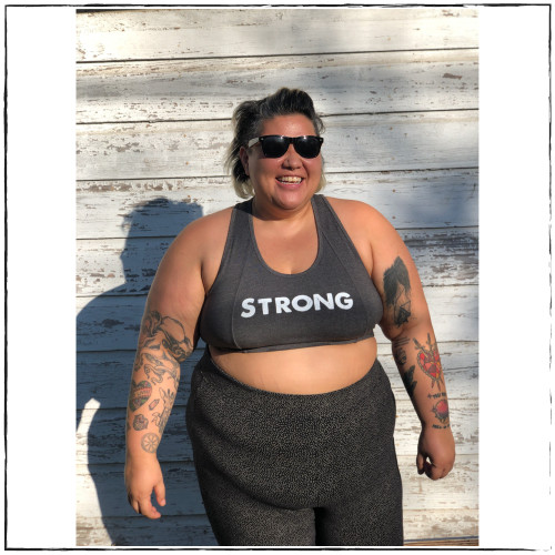 "This is the perfect sports bra with a racerback cut on the back. This bra, made by woman-owned fitness brand Strong Athletic is made from stretchy and soft material that shapes around your chest perfectly. The word ""strong"" is printed in bold white ink across the front of the exercise bra and on the back of the bra is our signature Strong Athletic logo. This low-impact bra is perfect for wearing to the gym, wearing to the beach or wearing out as a crop. The sizing of this bra ranges from X-small to 3X-Large. Make sure to check out the size chart for accuracy."