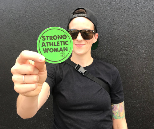 This is the Strong Athletic Woman Sticker by Strong Athletic. This green sticker with black ink is a perfect way to make a statement about who you are and what you believe in.