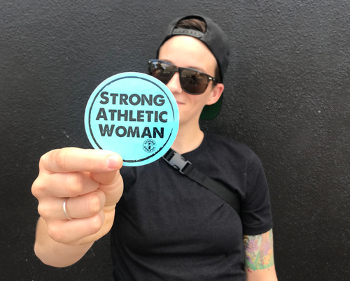 This is the Strong Athletic Woman Sticker by Strong Athletic. This light blue sticker with black ink is a good reminder to all of us that women are strong and athletic and belong in sport. #strongathleticwoman #womenwholift