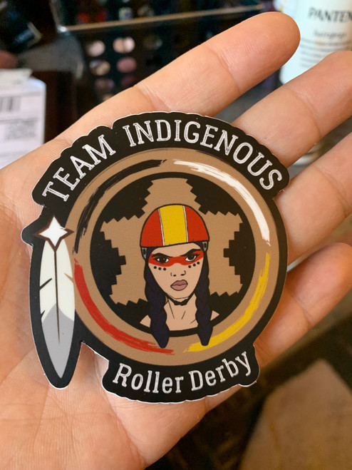 "This is the Team Indigenous Rising Logo Sticker. The design is cut out of the sticker, so the uniqueness includes the feather and the letters being ""etched out"" of the sticker. We love this design. 80% of profits from this Sticker goes directly to Team Indigenous Rising."