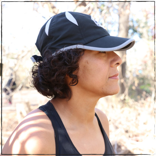 This is the side view of the Strong Athletic Super Light Weight Runner's Hat with our logo embroidered on the front. We love this hat because it is breathable and the bill is the perfect length, shading our eyes from the sun whenever we wear it.