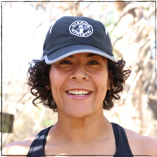 This is the Strong Athletic Super Light Weight Runner's Hat with our logo embroidered on the front. This runner's hat is adjustable with a velcro strap. The reflective band makes it easier to see in the dark when light shines on it. The breathable material is also machine washable. This hat can be folded into a smaller size and will bounce right back to it's original shape.
