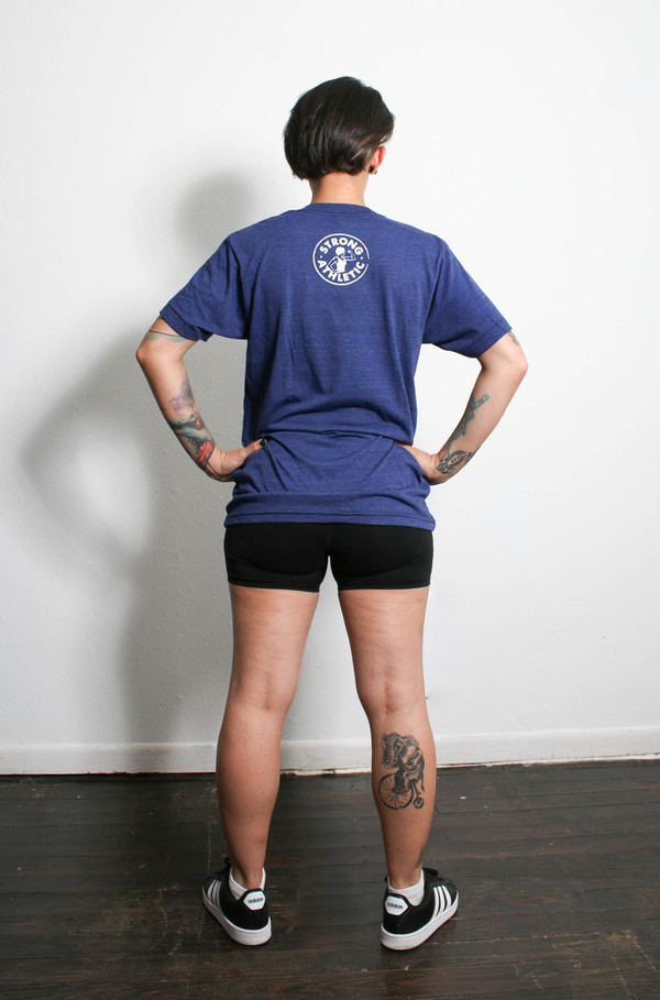 This is the back of the Strong Athletic Mom t-shirt. We love this shirt because it is stretchy, but hangs nicely without being clingy. You also won't get lost in the shirt, especially if you order it one size smaller than a typical cis woman's shirt. This shirt is perfect for a strong mom on the go!