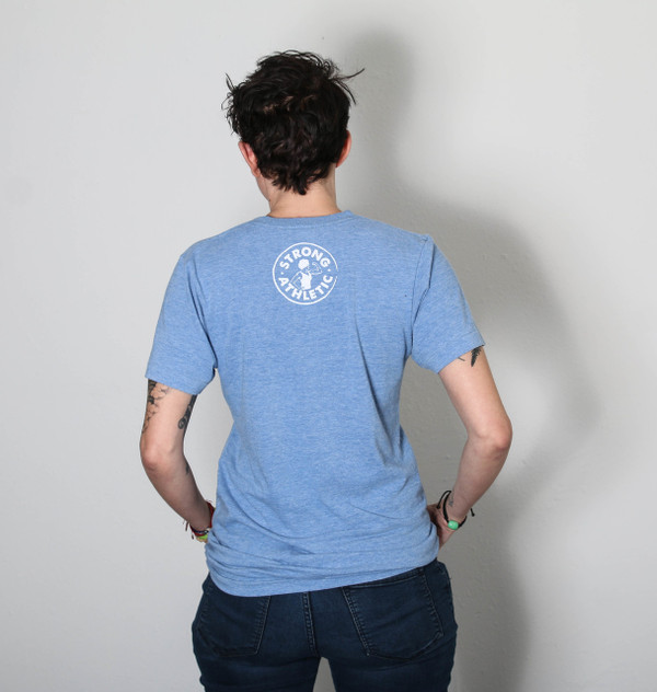 Back of the Strong Nasty Woman T-shirt. American Apparel Light-blue tri-blend track t-shirt with white ink. Tell the world you're a Nasty woman. This shirt was hand printed and designed by women in Austin, Texas by Strong Athletic, a local business.