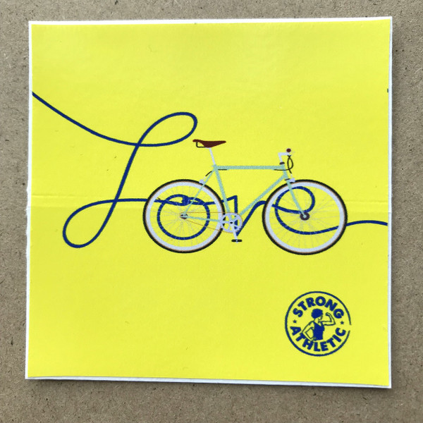 The Love is a Bicycle sticker was inspired by Nadia who believes that there should be more love in the world. Nadia is a cyclist and spent many years dependent on her bike. Why choose to put her focus on love being a bicycle, especially when the majority of the people that follow Strong Athletic are adamant roller skaters? Why not, is what we ask? Why not?