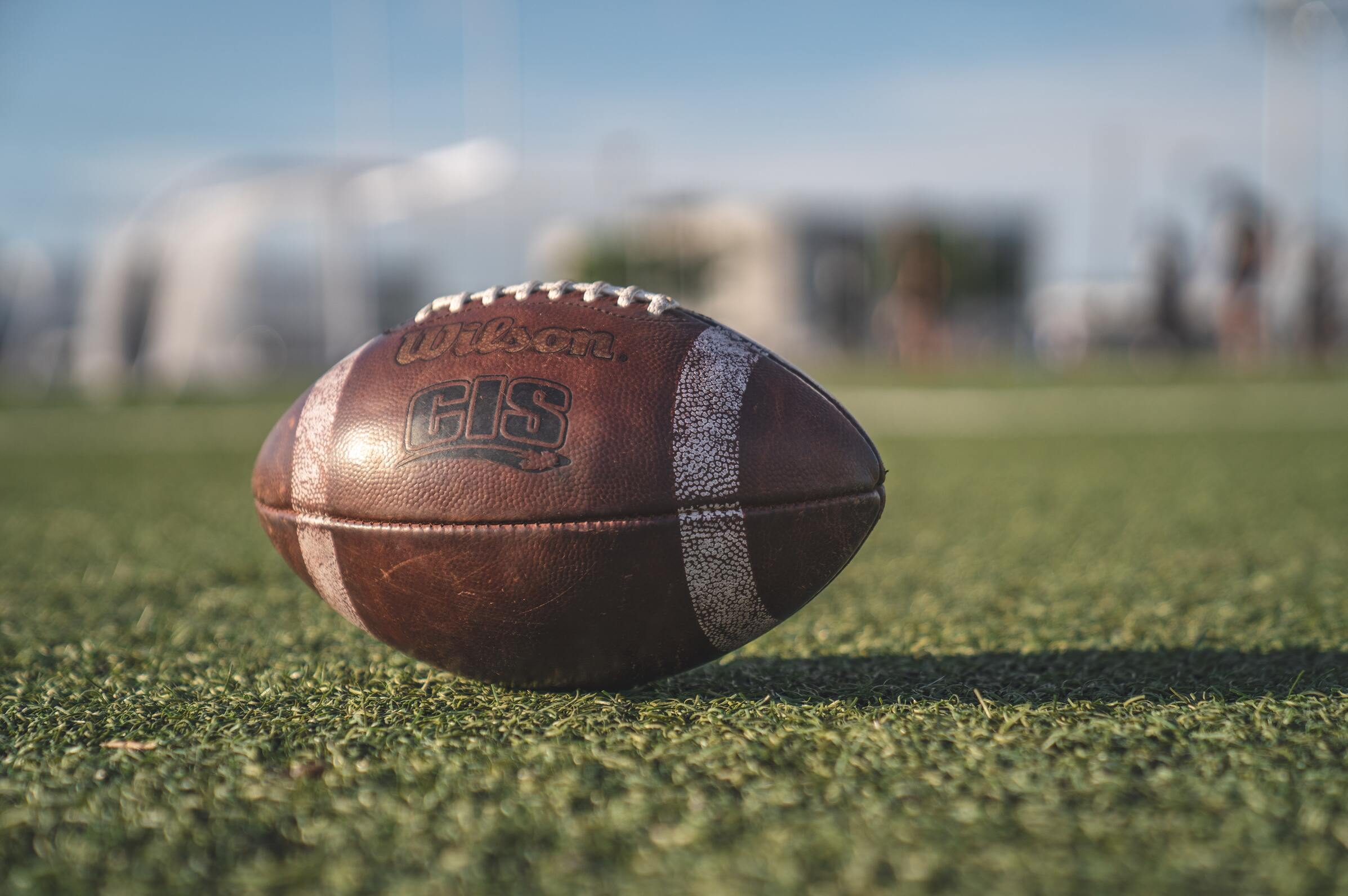 A football sitting on a football field
