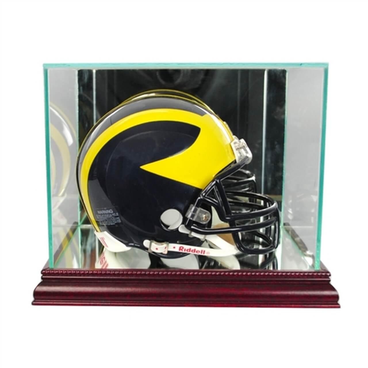 A mini football helmet in a display case