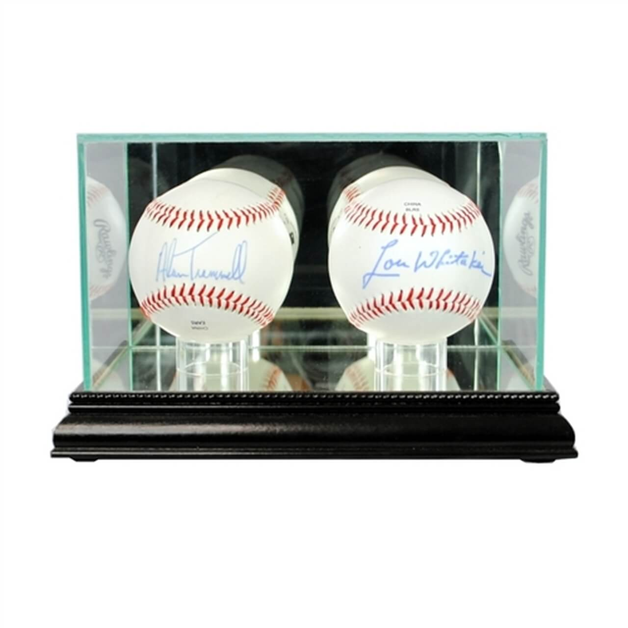 Two baseballs inside a glass display case
