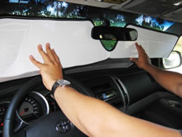 STEP 2: Tuck HeatShield behind rearview mirror, if mounted on windshield. It is okay to bend HeatShield.