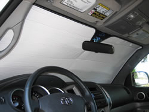 STEP 3: Lift HeatShield against glass. Adjust HeatShield in windshield, may overlap slightly with side windshield frame (A-pillars) and headliner.