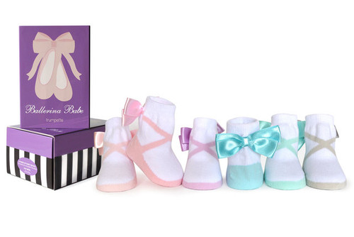 "Your prima ballerina will be dancing her way into style in our six pairs of pastel ballerina babe baby socks adorned with a matching satin bow in a gift box.  6 Pack Cotton rich socks are comfortable for your baby to wear all day Socks also contain small amounts of nylon and spandex 75% cotton, 22% nylon, 3% spandex Slip resistant material (""Trumpette"") on sock's bottom helps give baby's feet traction Mom approved - with soft elastic tops, Trumpette socks stay on baby's feet Gift box packaging surprises and delights at baby showers Made in Korea Machine wash cold. Tumble dry low. Do not bleach."