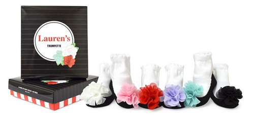 Six pairs of our black pixie style shoe sock with a bright chiffon flower on the vamp. Packaged in a gift box.  Cotton rich socks (75% Cotton, 22% Nylon, 3% Spandex) are comfortable for your baby to wear all day Socks also contain small amounts of nylon and Spandexx Slip resistant material on sock's bottom helps give baby's feet traction Moms approved - with soft elastic tops, Trumpette socks stay on baby's feet Gift box packaging surprises and delights at baby showers Made in Korea 6 socks Machine wash cold. Tumble dry low. Do not bleach