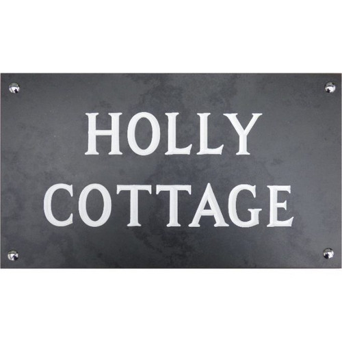 An engraved Welsh slate house sign with two lines of wording.