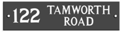 An engraved Welsh slate house sign with a house number and two lines of wording.