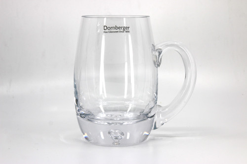 A barrel shaped 1 pint glass tankard with a bubble blown into the base.