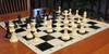 Standard Club Plastic Chess Set Black & Ivory Pieces with Black Roll-up Chess Board