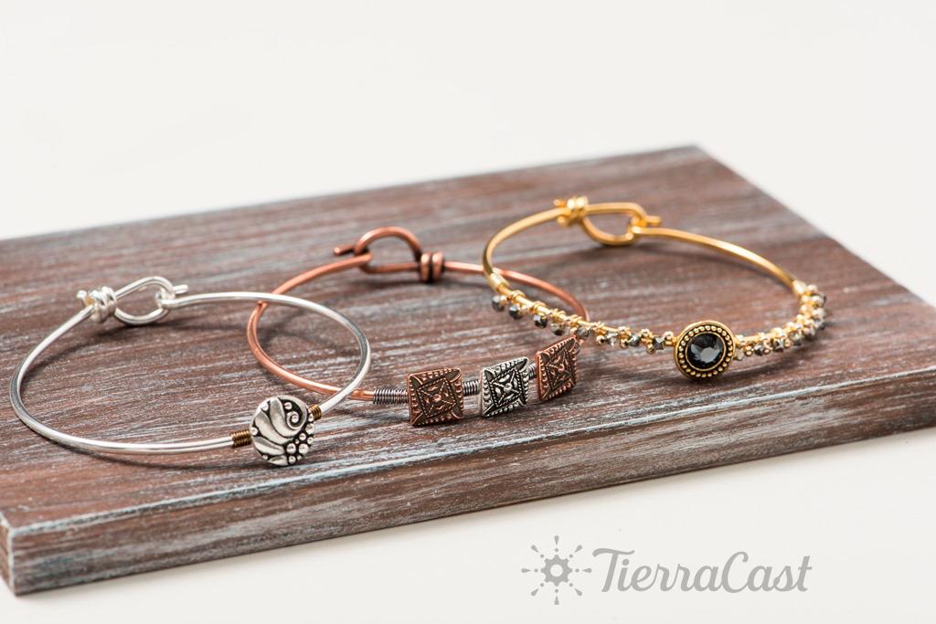 buttoned-up-bracelets-w-logo-1024px.jpg