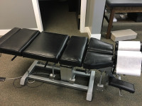 Black used Omni elevation  chiropractic drop table Generation 2