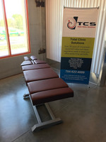 Omni Air Drop Elevation Chiropractic adjusting table viewed from back, color oxblood.