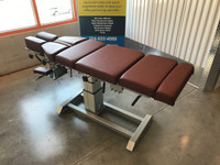 Omni Air Drop Elevation Chiropractic Table Raised Up to max height, color oxblood.