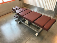 Omni Air Drop Elevation Chiropractic adjusting table viewed from left hand side, color oxblood.