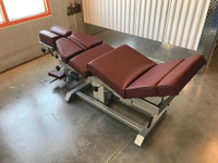 Omni Air Drop Elevation Chiropractic adjusting table viewed from left hand side with options raised, color oxblood.