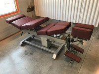 Omni Air Drop Elevation Chiropractic adjusting table viewed from right hand side with options raised color oxblood.