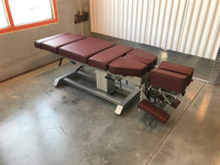 Omni Air Drop Elevation Chiropractic adjusting table viewed from right hand side, color oxblood.
