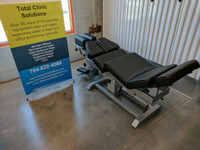 Omni Air Drop Elevation Chiropractic adjusting table viewed from left hand side options up, color black.