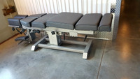 Omni Air Drop Elevation Chiropractic adjusting table viewed from left hand side, color charcoal.