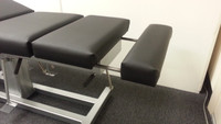 Used reconditioned Omni Stationary with black vinyl ankle slide out