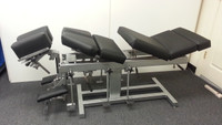 Reconditioned Omni Chiropractic Adjusting Table 4 drops and toggle with all elevating sections elevated up