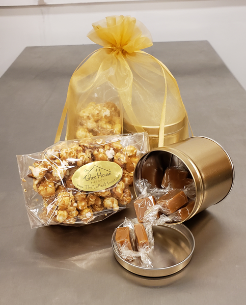 A 4 oz. bag of Toffee Popcorn together with a 4 oz. tin of Sea Salt Caramels tied together in an organza bag.