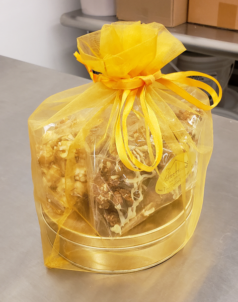A delicious combination of Chocolate Toffee Popcorn, Toffee Popcorn, and The Dangerous Stuff Toffee. All of it wrapped in a festive organza bag.