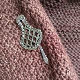 Marrakech shawl pin on knitwear