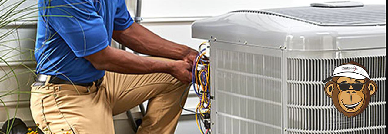 Technician working on air-conditioner condenser