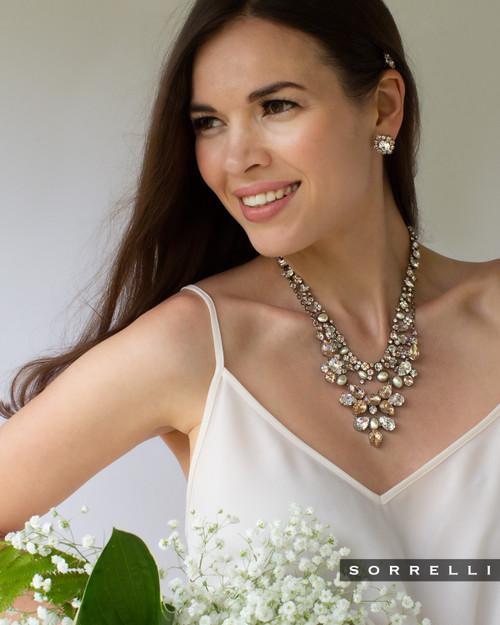 Girl wearing sorrelli soft petal crystal necklace nde59aspls
