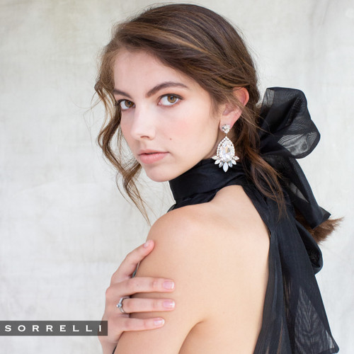 side face girl wearing sorrelli glacier crystal earrings eef52asglc