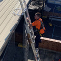Roofer using ANKAme Ladder Access Bracket