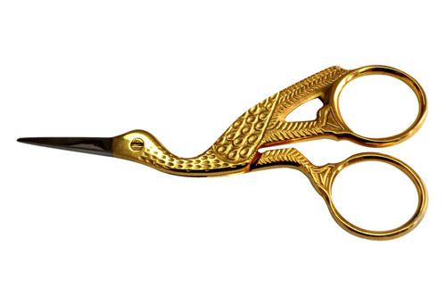 Metal scissors in the shape of a stork, With 3 cm straight blade, Comes in gold color.