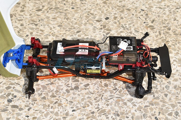 GPM Alum Adjustable Front & Rear Damper Mount Orange : SCX24 Deadbolt / Wrangler