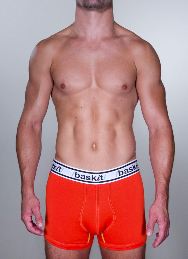 Baskit Light Trunk in blood orange color front.