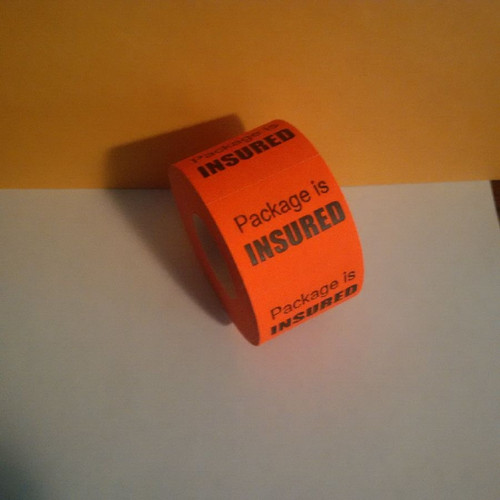 PACKAGE IS INSURED LABELS Roll of 500 stickers for mail use