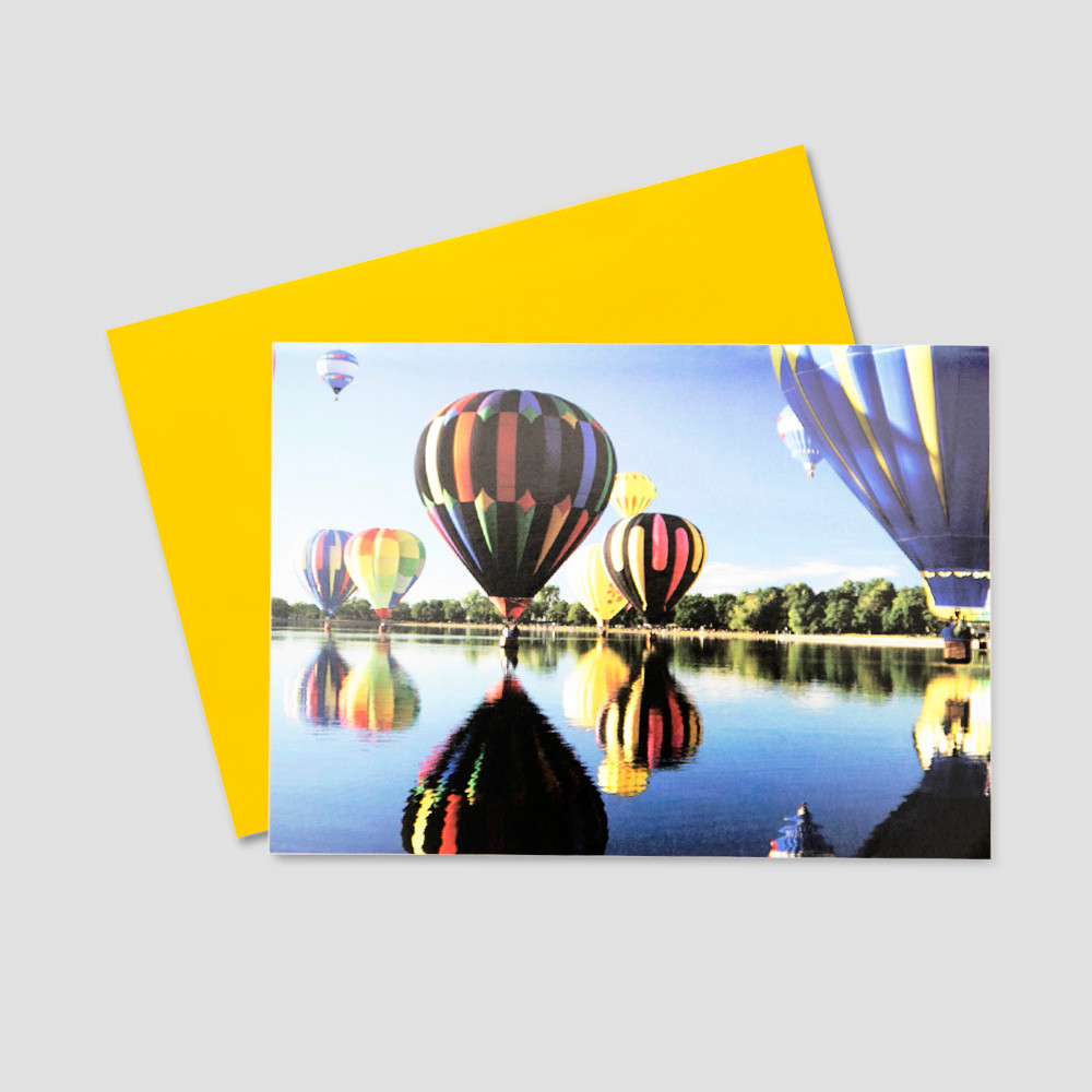 Employee Birthday greeting card featuring many colorful hot air balloons floating over a lake on a bright, sunny day