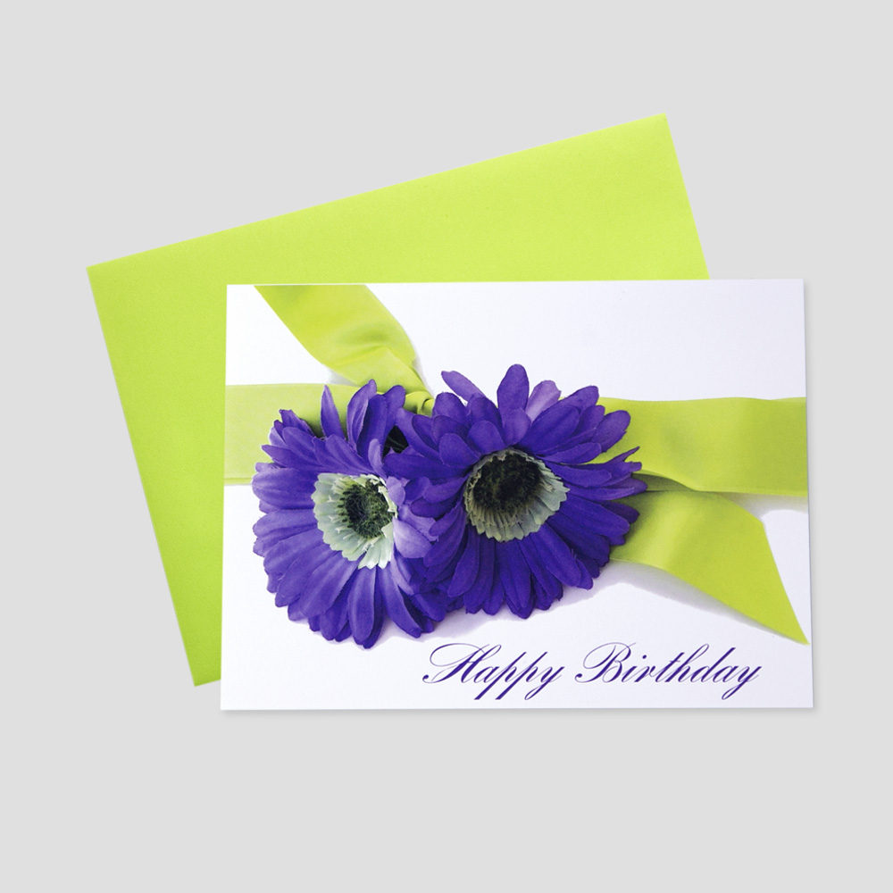 Work Birthday greeting card featuring a happy birthday message in a script font and delicate purple flowers and a lime green bow