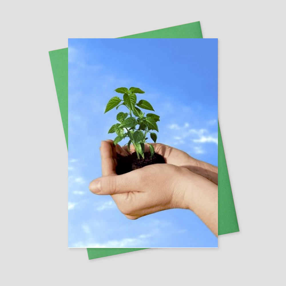 Business Earth Day greeting card featuring two hands holding a sprouting plant in fresh soil
