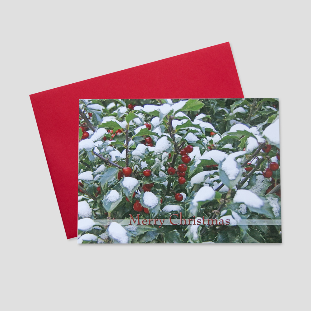 Company Christmas greeting card featuring a Merry Christmas message surrounded by holly berries covered in snow